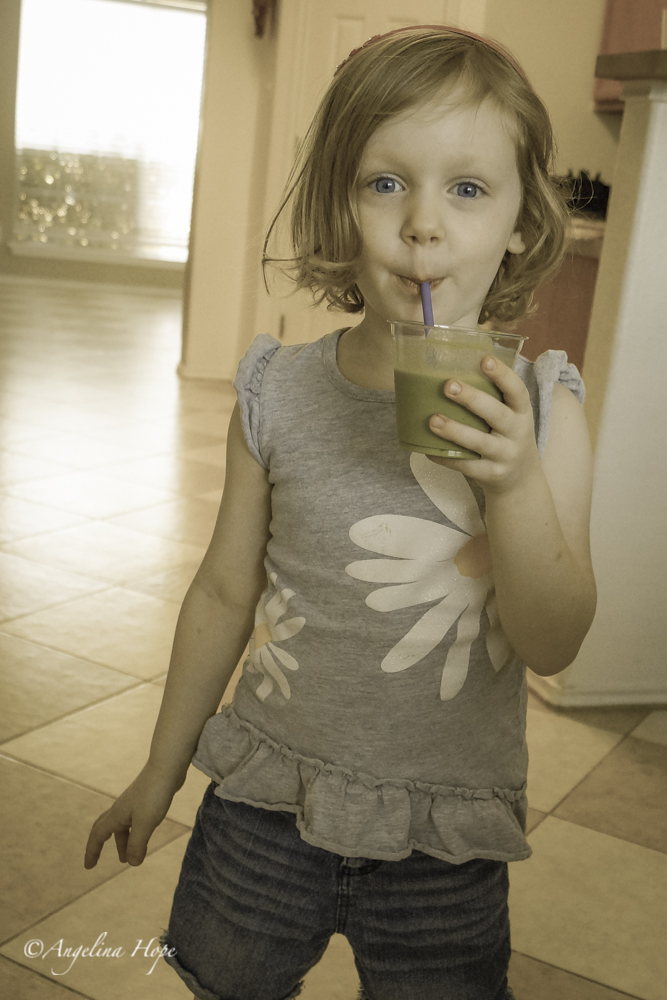 Mariella enjoying her green smoothie too.  She looks so grown up!